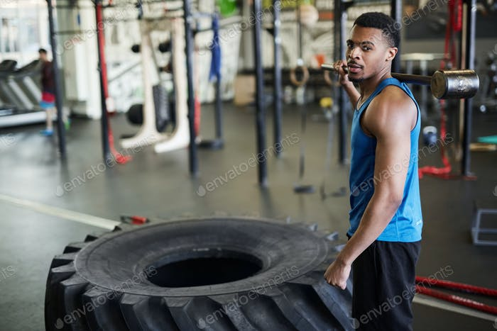 Handsome African Sportsman posing in Gym