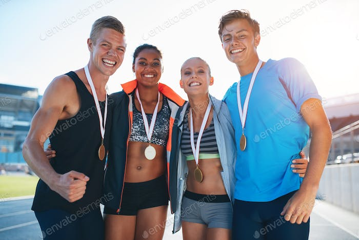 Happy multiracial athletes celebrating victory