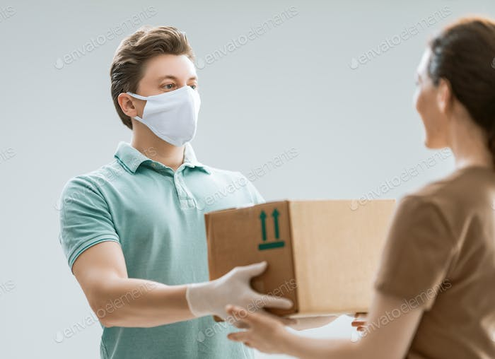 Woman accepting boxes from courier.