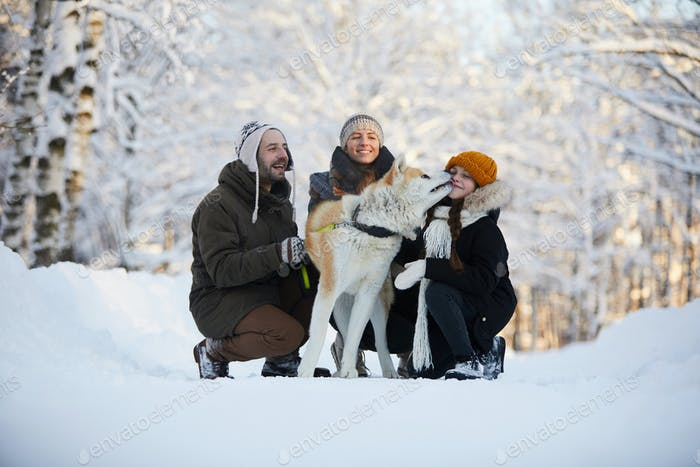 Happy Family with Dog Outdoors