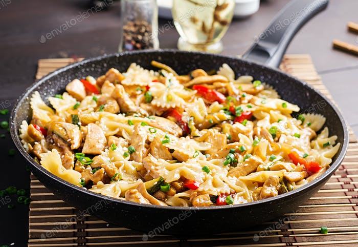 Stir fry chicken, pasta farfalle, zucchini, sweet peppers and green onion.  Asian cuisine
