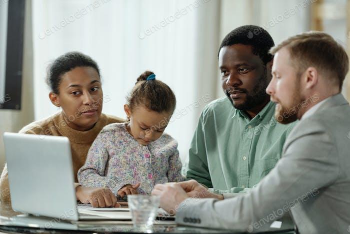 African American family having visit of adviser