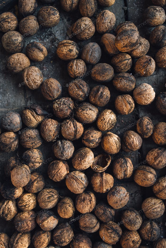 Pile of walnuts on the table, top view