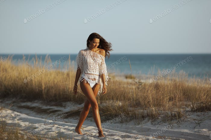 Woman Walking on the Beach During Vacation