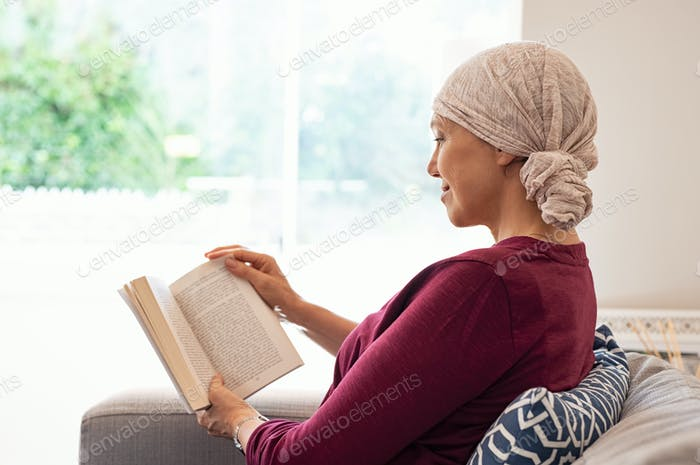 Cancer mature woman reading book