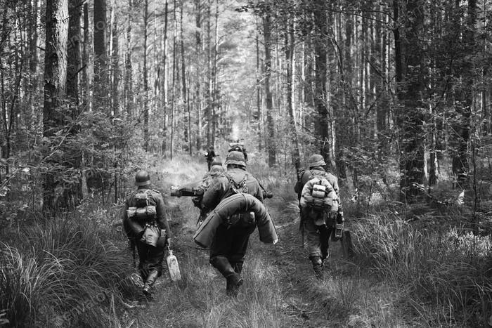 German Infantry Soldiers In World War II Marching Walking Along