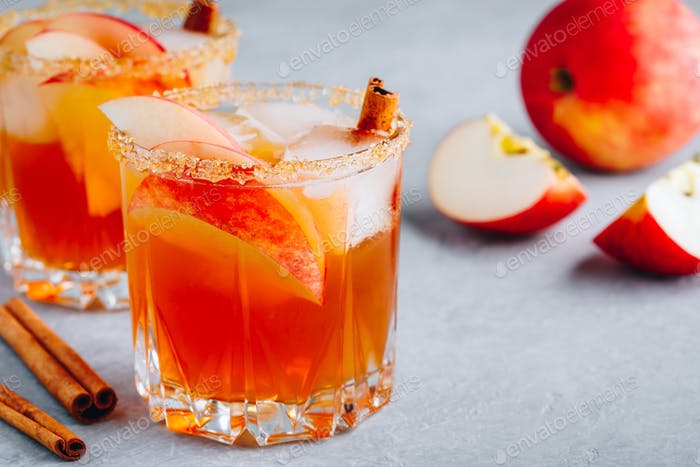 Harvest apple punch with cinnamon and ice for Halloween or Thanksgiving in glass