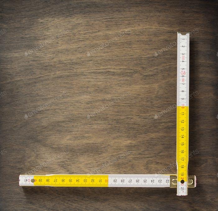 meter ruler on wood
