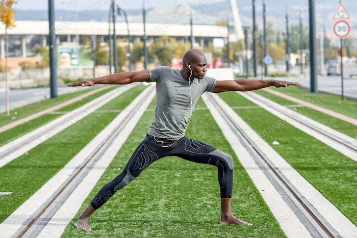 Thumbnail for Black man practicing yoga in urban background