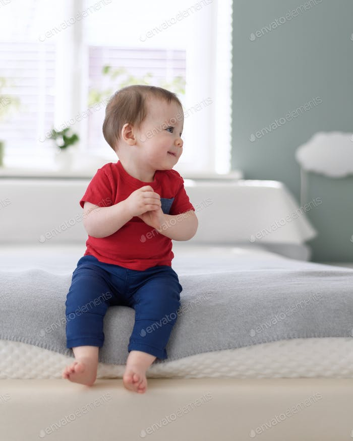 Happy baby boy in red shirt