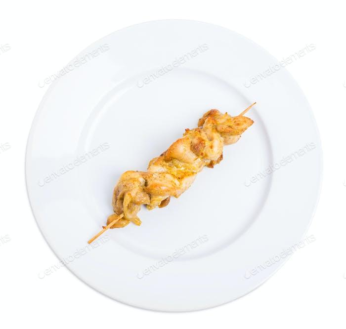 Grilled chicken fillet shish kebab.