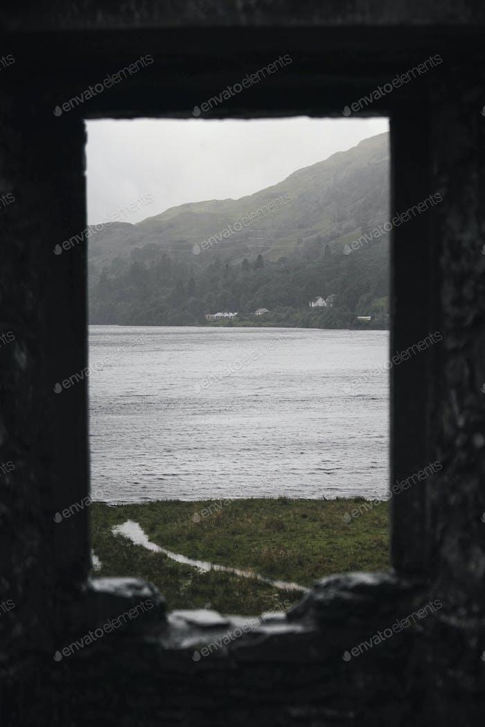 Sea view through a rocky window of Kilchurn Castle, Scotland