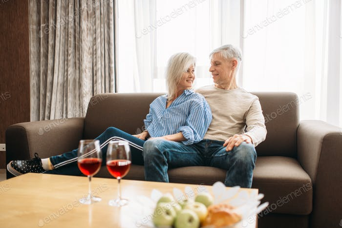Romantic dinner of adult love couple at home