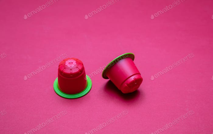 Coffee espresso capsules, eco friendly, compostable on red background