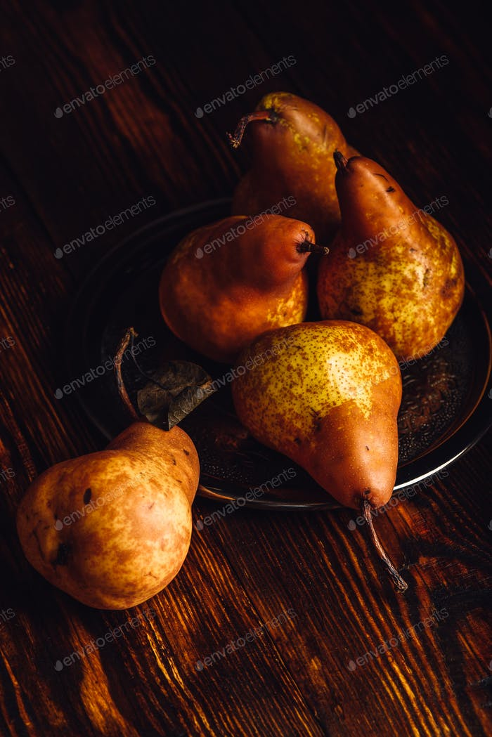 Few Golden Pears on Table.