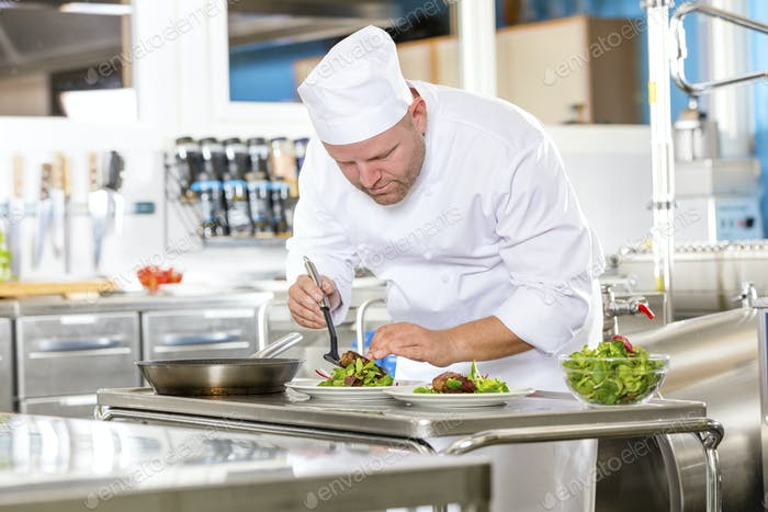 Chef prepares steak dish at gourmet restaurant kitchen