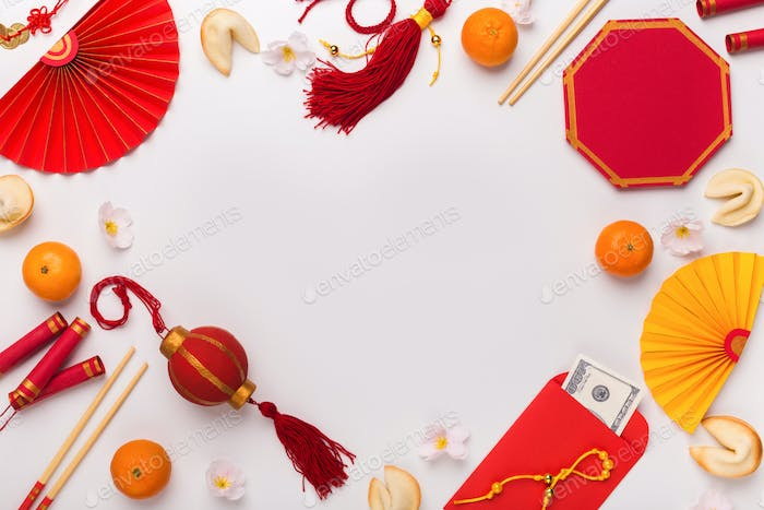 Chinese New Year decorations creating frame on white