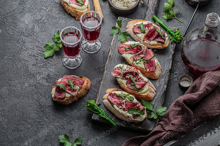 Crostini with Beef Tartare and Rocket, copy space