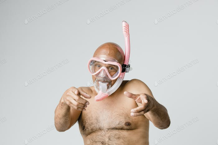 Senior man wearing a snorkel scuba mask