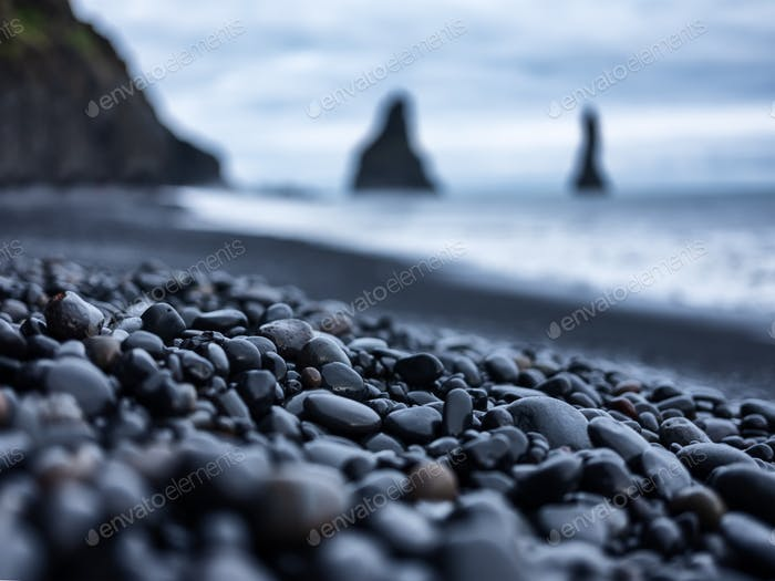 Black pebbles as a background in the Iceland sea shore.
