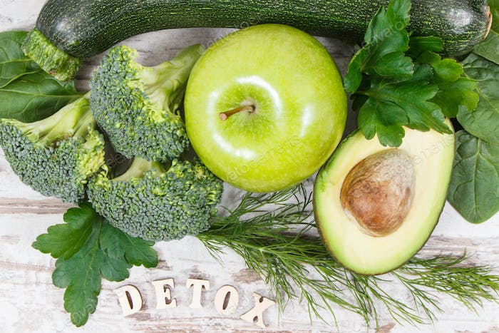 Inscription detox with fruits and vegetables containing natural minerals, vitamins and fiber