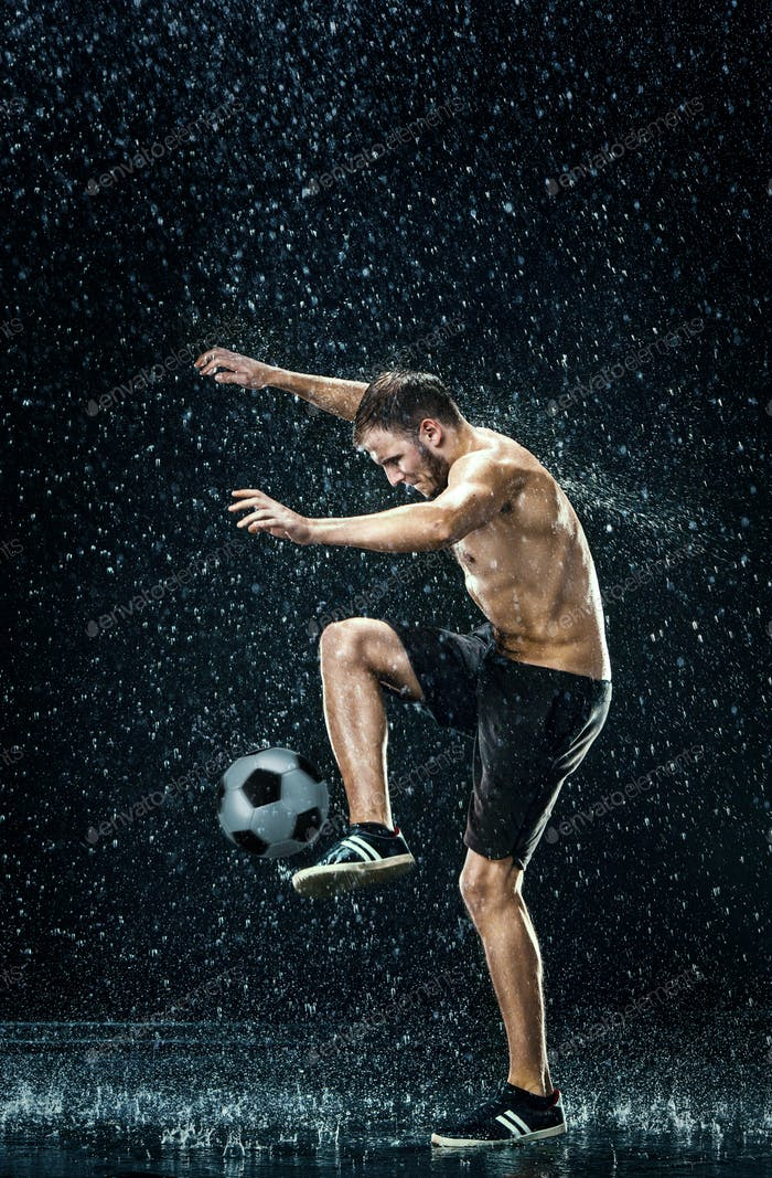 Water drops around football player under water
