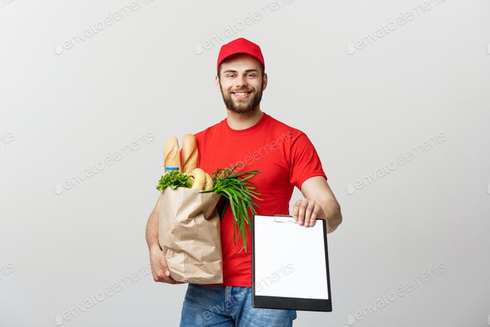 Delivery Concept: Handsome Caucasian grocery delivery courier man in red uniform with grocery box