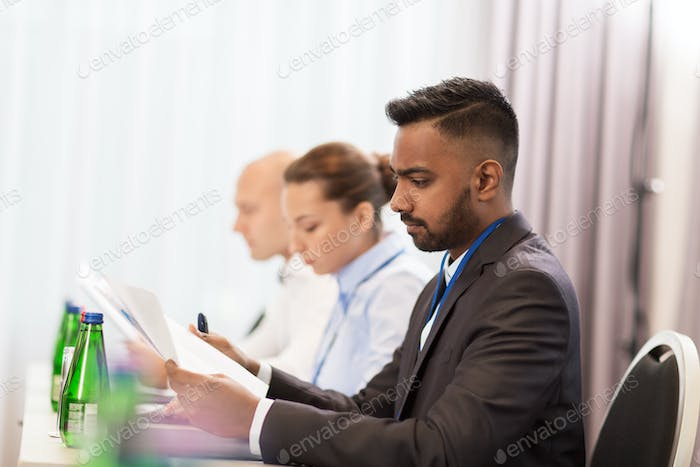businessman with files at international conference