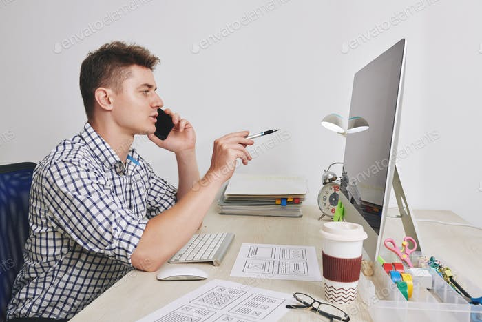 UX designer talking on phone