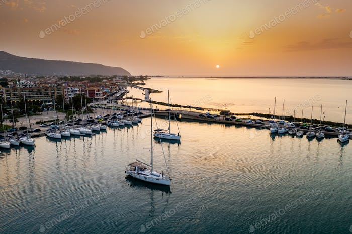 Sailboats in the marina and the city of Lefkada island, Greece