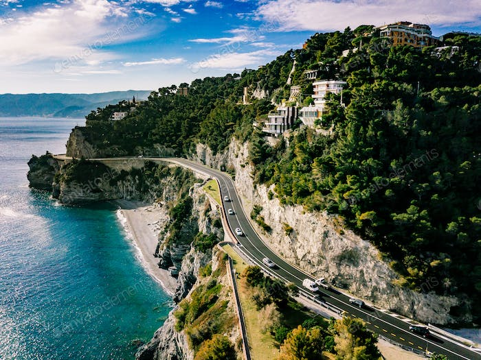 Aerial view of road going through beautiful landscape by the sea in Italy