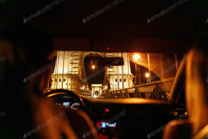 unusual view from car at chain famous bridge in Budapest city