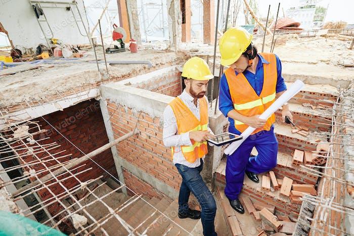 Builders discussing plan of work
