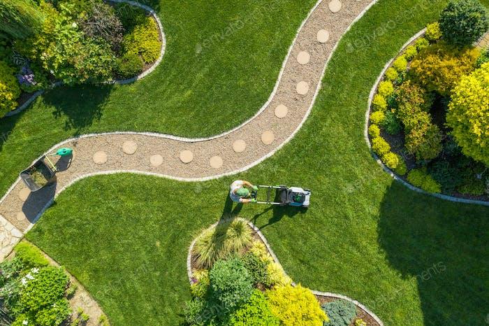 Big Garden Grass Field Mowing by Caucasian Gardener