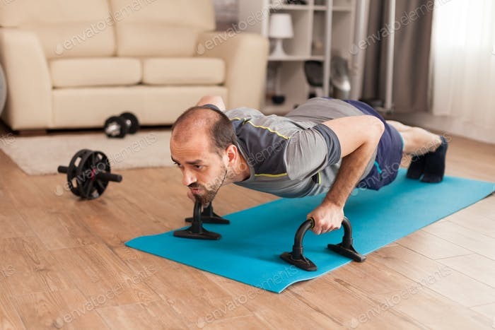 Fit man increase his chest strength doing push ups