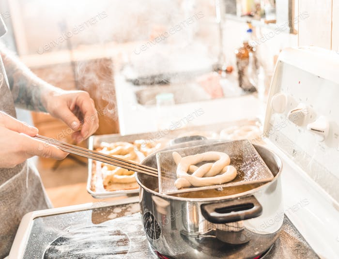Pretzel being prepared and parboiled in Boiling Water.