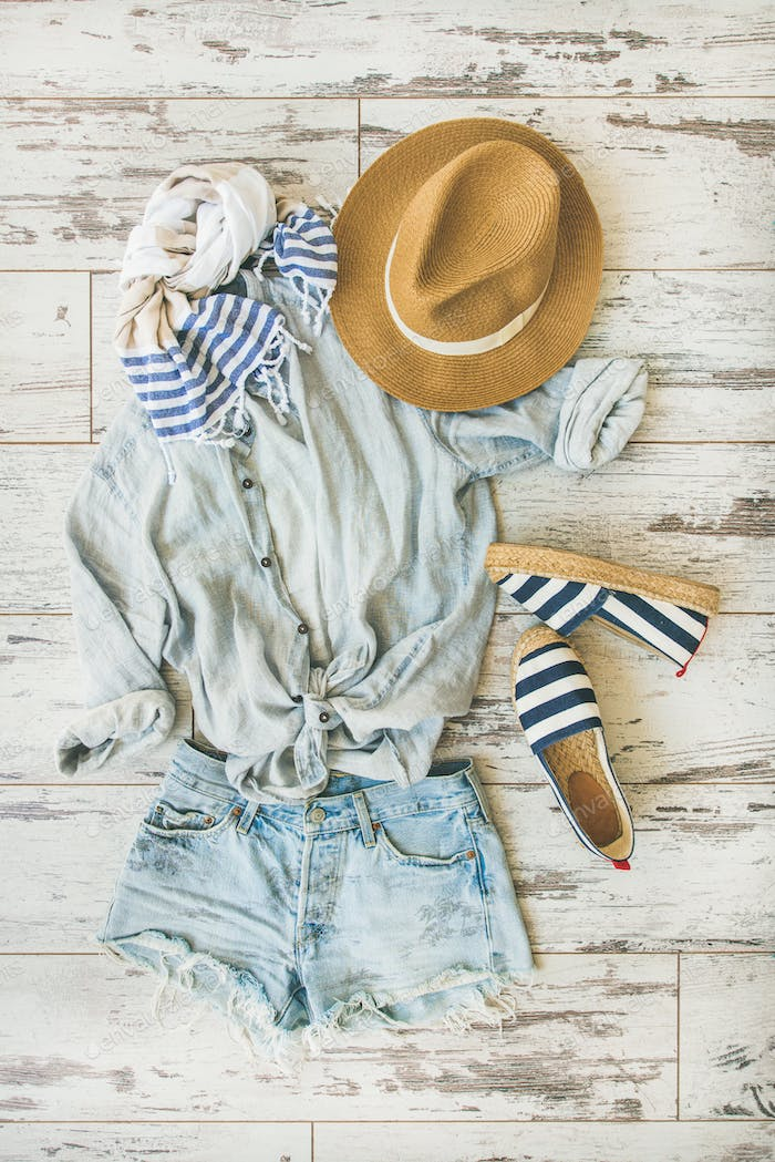 Summer outfit flatlay, parquet background, top view