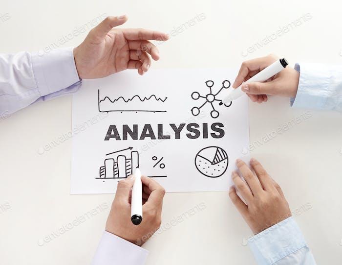 Crop hands working on analysis scheme