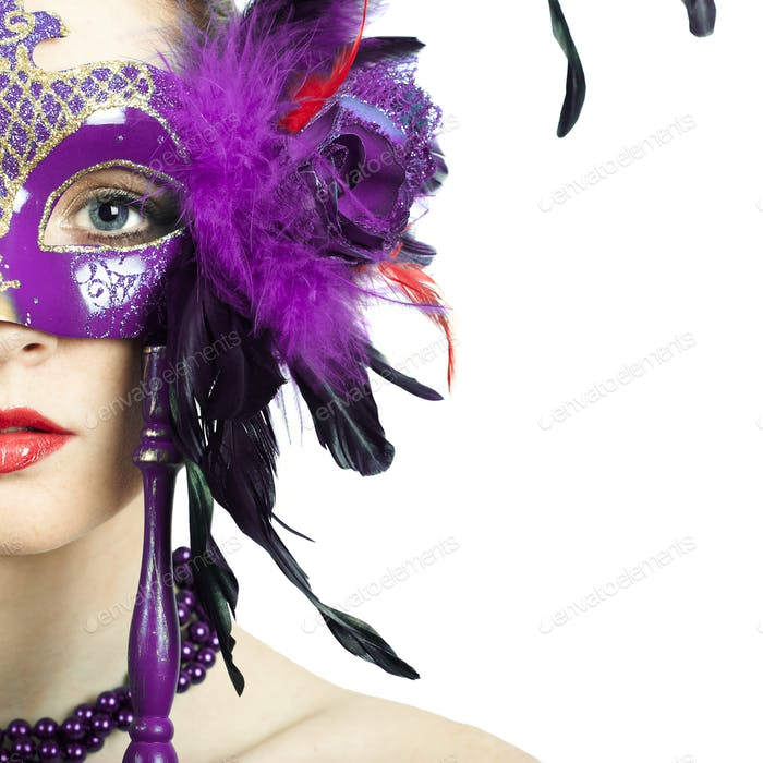 Beauty model woman wearing venetian masquerade carnival mask