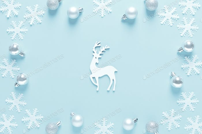 Christmas, New Year or Noel holiday festive winter greeting card, balls, deer and snowflakes