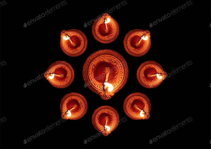 Happy Diwali. Diya oil lamps against dark background,