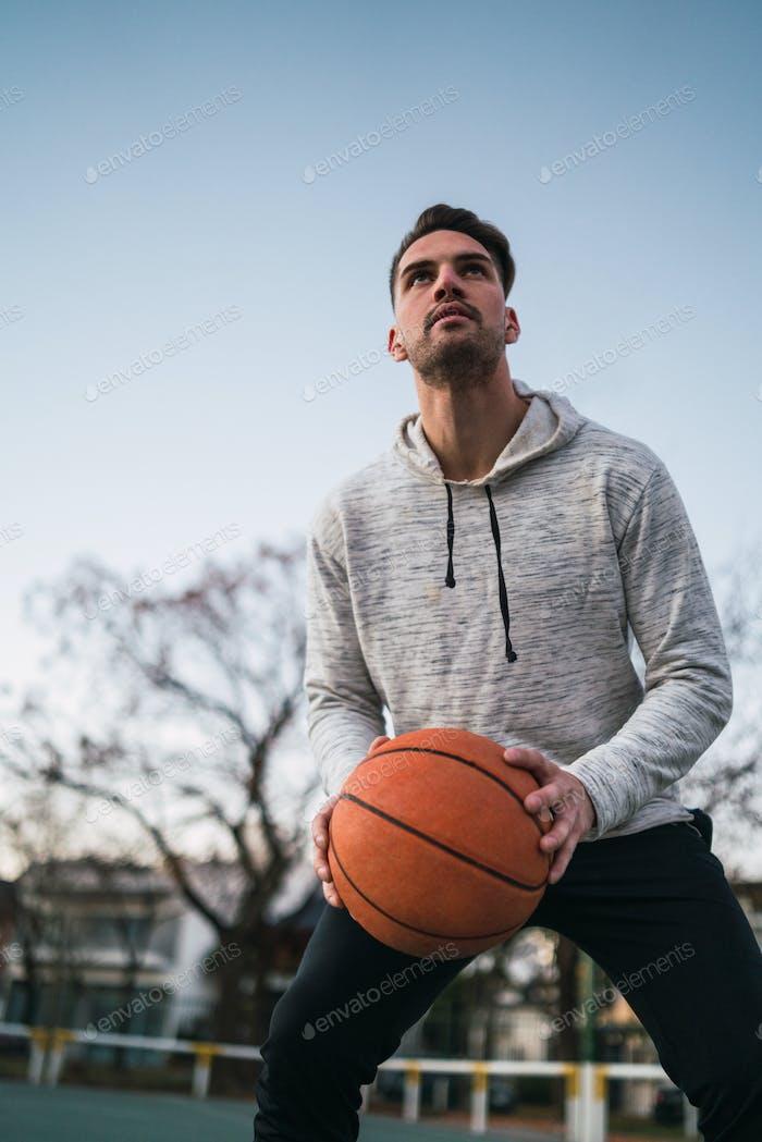 Young man playing basketball.