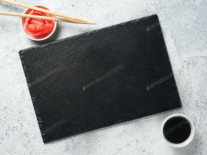 Empty slate, chopsticks, soy sauce, pickled ginger