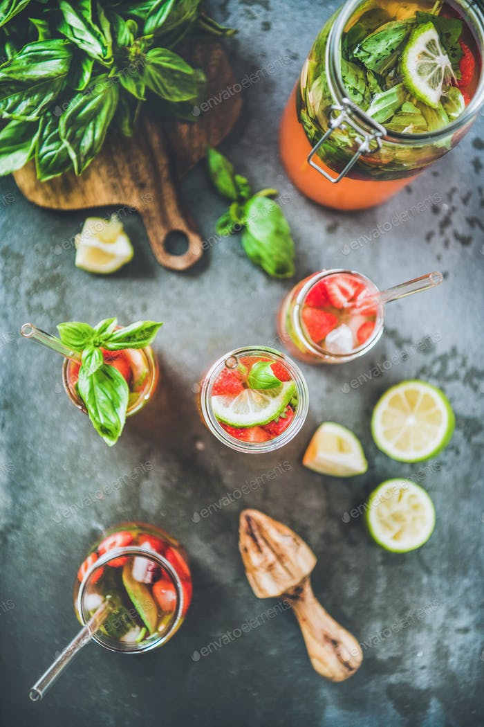 Fresh homemade lemonade with strawberry and basil leaves and ingredients