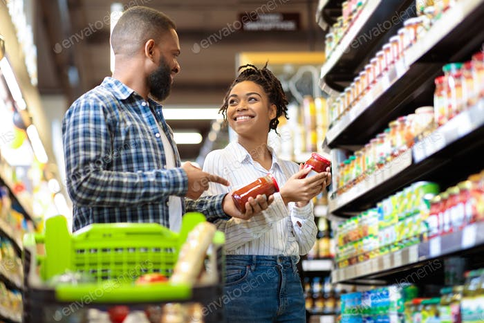 Black Family Couple Shopping Groceries In Supermarket Buying Food