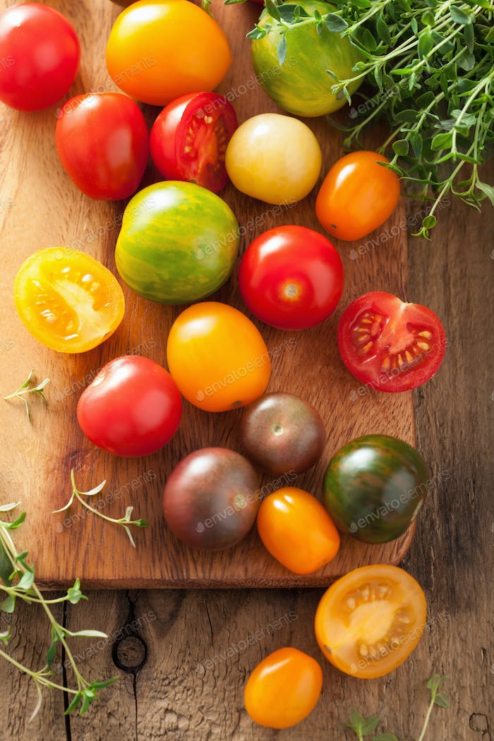 colorful tomatoes over wooden background