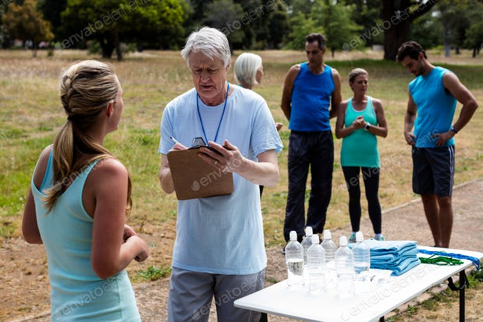 Volunteer registering athletes name for race