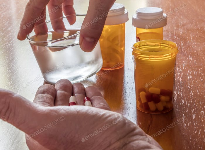 Sick person taking daily medication, conceptual image