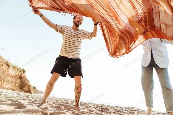 Couple outside at the beach with blanket