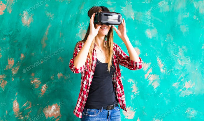 woman getting experience using VR-headset glasses of virtual reality
